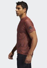 adidas Performance - FREELIFT T-SHIRT - T-shirt print - orange - 2
