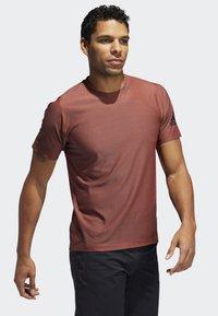 adidas Performance - FREELIFT T-SHIRT - T-shirt print - orange - 4