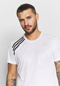 adidas Performance - OWN THE RUN TEE - T-shirts med print - white/black - 3