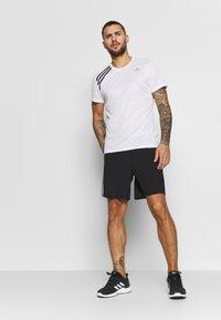 adidas Performance - OWN THE RUN TEE - T-shirts med print - white/black - 1
