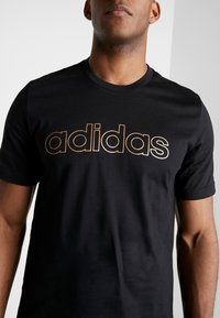 adidas Performance - ESSENTIALS SEASONAL SHORT SLEEVE TEE - Print T-shirt - black - 4