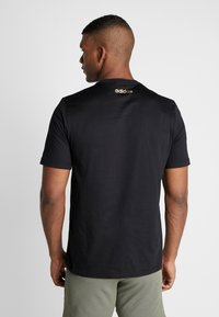adidas Performance - ESSENTIALS SEASONAL SHORT SLEEVE TEE - Print T-shirt - black - 2