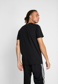 adidas Performance - 8 BIT - T-shirt print - black - 2