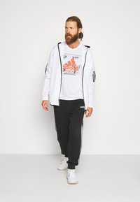 adidas Performance - FAST TEE - T-shirts med print - white - 1