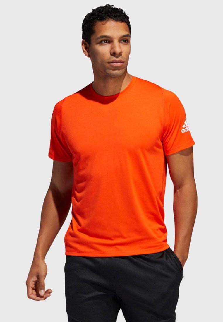 adidas Performance - FREELIFT TECH - Sports shirt - orange (506)