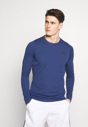 TEE HEAT.RDY - Sports shirt - blue/grey
