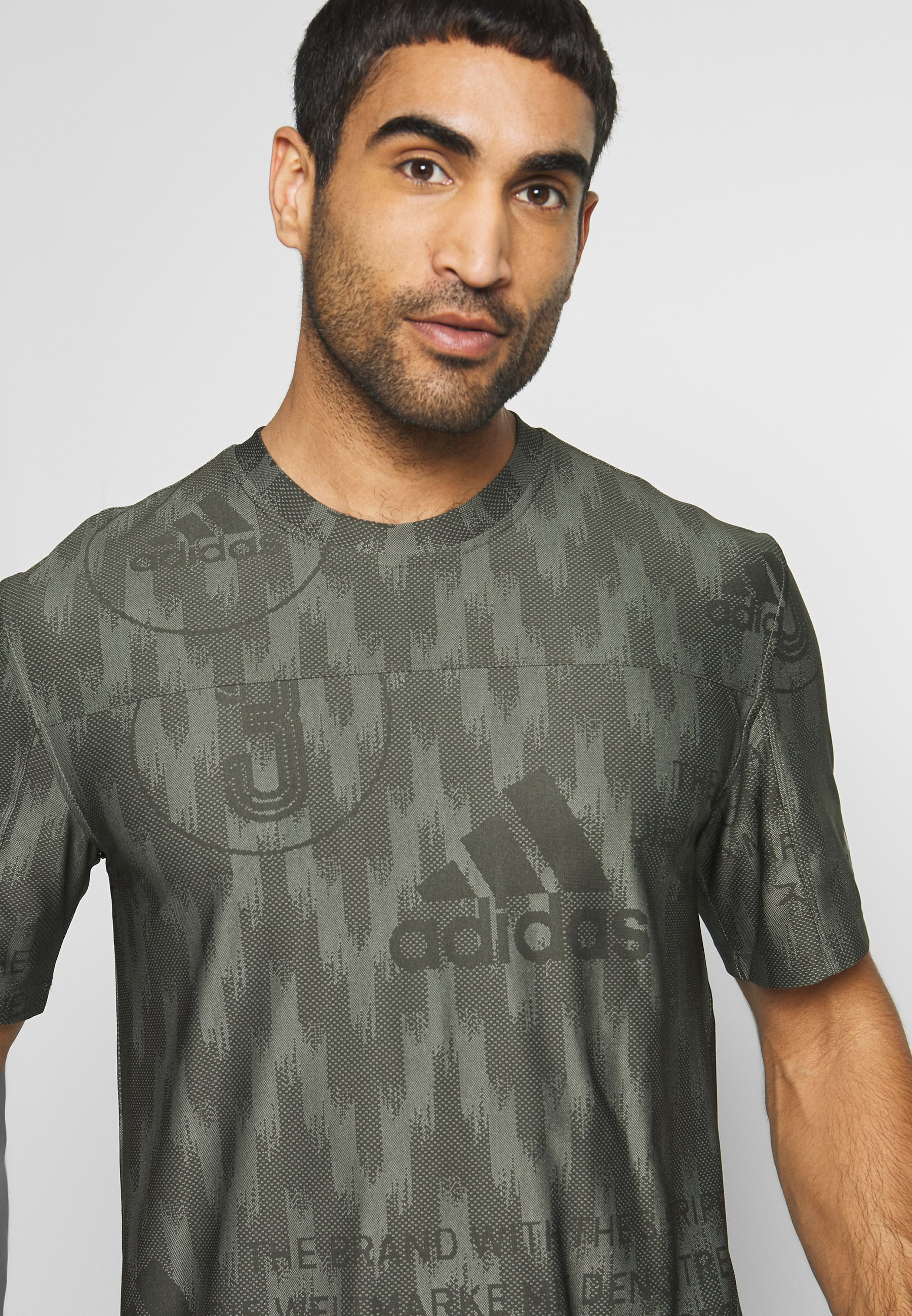 adidas Performance CITY TEE - T-shirt imprimé - green