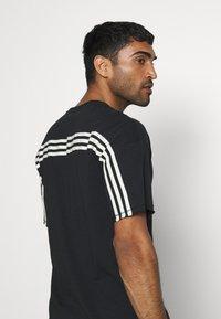 adidas Performance - TEE - T-shirt con stampa - black - 3