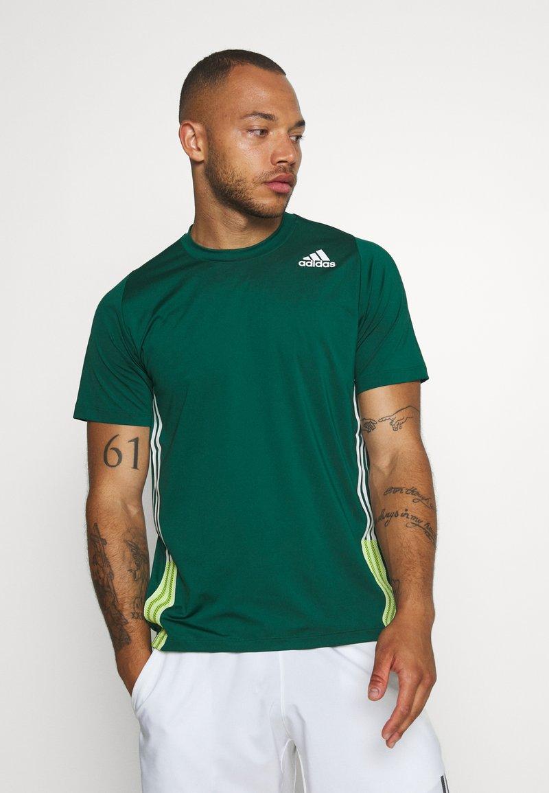 adidas Performance - TEE - T-shirt print - green