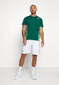 adidas Performance - TEE - T-shirt print - green - 1