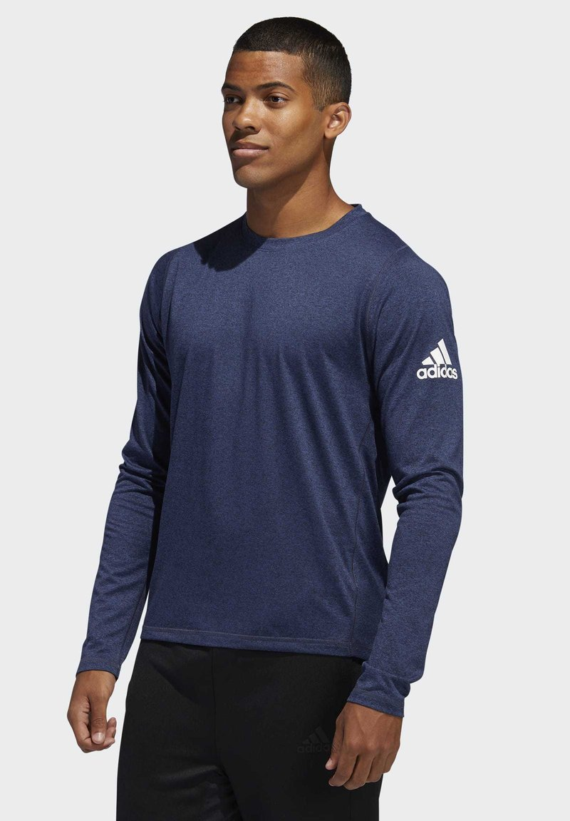 adidas Performance - FREELIFT SPORT HEATHER BADGE OF SPORT LONG-SLEEVE TOP - Sports shirt - mottled blue