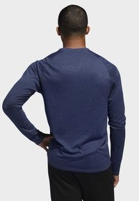 adidas Performance - FREELIFT SPORT HEATHER BADGE OF SPORT LONG-SLEEVE TOP - Sports shirt - mottled blue - 1