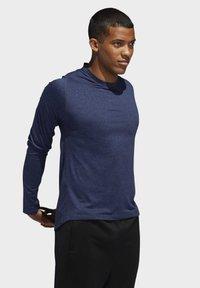 adidas Performance - FREELIFT SPORT HEATHER BADGE OF SPORT LONG-SLEEVE TOP - Sports shirt - mottled blue - 3