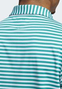 adidas Golf - ADIPURE ESSENTIAL STRIPE POLO SHIRT - Sports shirt - green - 4