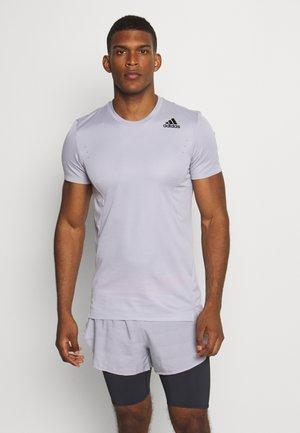 HEAT.RDY TRAINING SLIM SHORT SLEEVE TEE - T-shirt z nadrukiem - glow grey