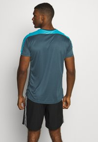 adidas Performance - RESPONSE PRIMEGREEN RUNNING SHORT SLEEVE TEE - Triko s potiskem - dark blue - 2