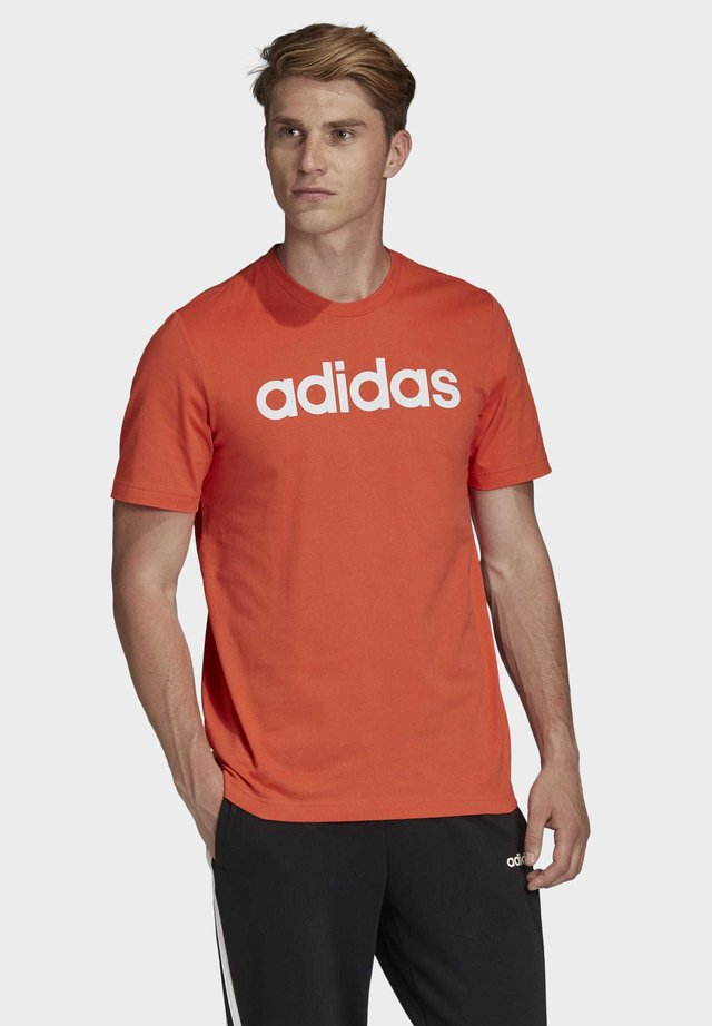 ESSENTIALS LINEAR LOGO T-SHIRT - T-shirt con stampa - orange