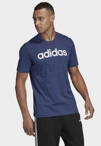 adidas Performance - ESSENTIALS LINEAR LOGO T-SHIRT - T-shirts med print - blue - 2