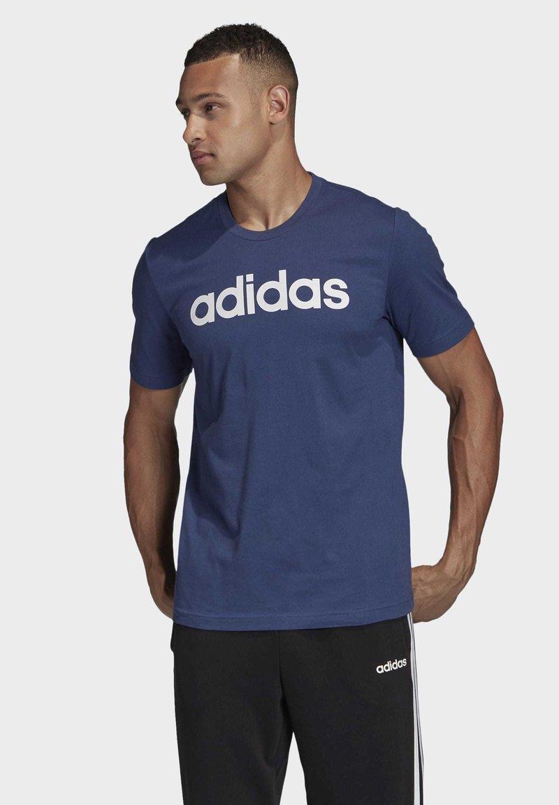 adidas Performance - ESSENTIALS LINEAR LOGO T-SHIRT - T-shirts med print - blue