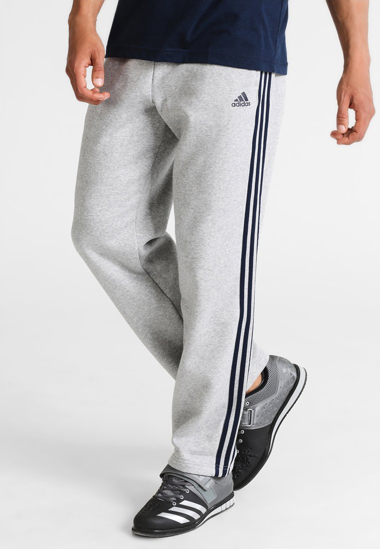 adidas Performance - ESSENTIAL - Tracksuit bottoms - medium grey heather/collegiate navy