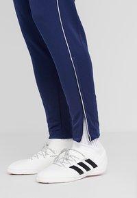 adidas Performance - CORE 18 - Tracksuit bottoms - dark blue/white - 3
