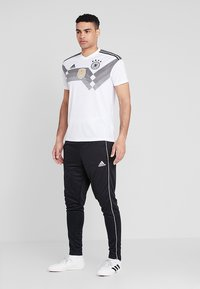 adidas Performance - CORE - Joggebukse - black/white - 1