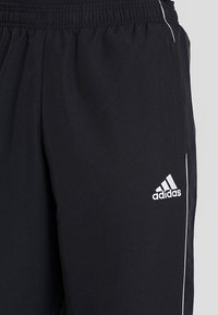 adidas Performance - CORE - Tracksuit bottoms - black/white - 4