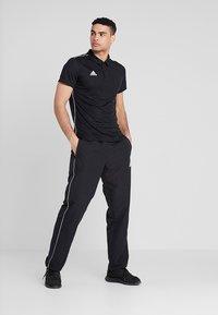 adidas Performance - CORE - Tracksuit bottoms - black/white - 1