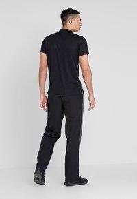 adidas Performance - CORE 18 - Tracksuit bottoms - black/white - 2