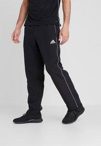 adidas Performance - CORE - Tracksuit bottoms - black/white - 0