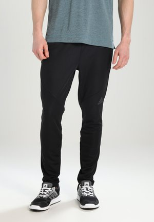 PANT CLITE - Pantalon de survêtement - black