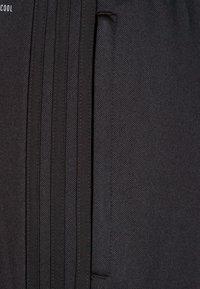adidas Performance - CONDIVO - Tracksuit bottoms - black/white - 2