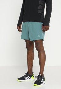 adidas Performance - SUPERNOVA SHORT - Sports shorts - rawgreen - 0