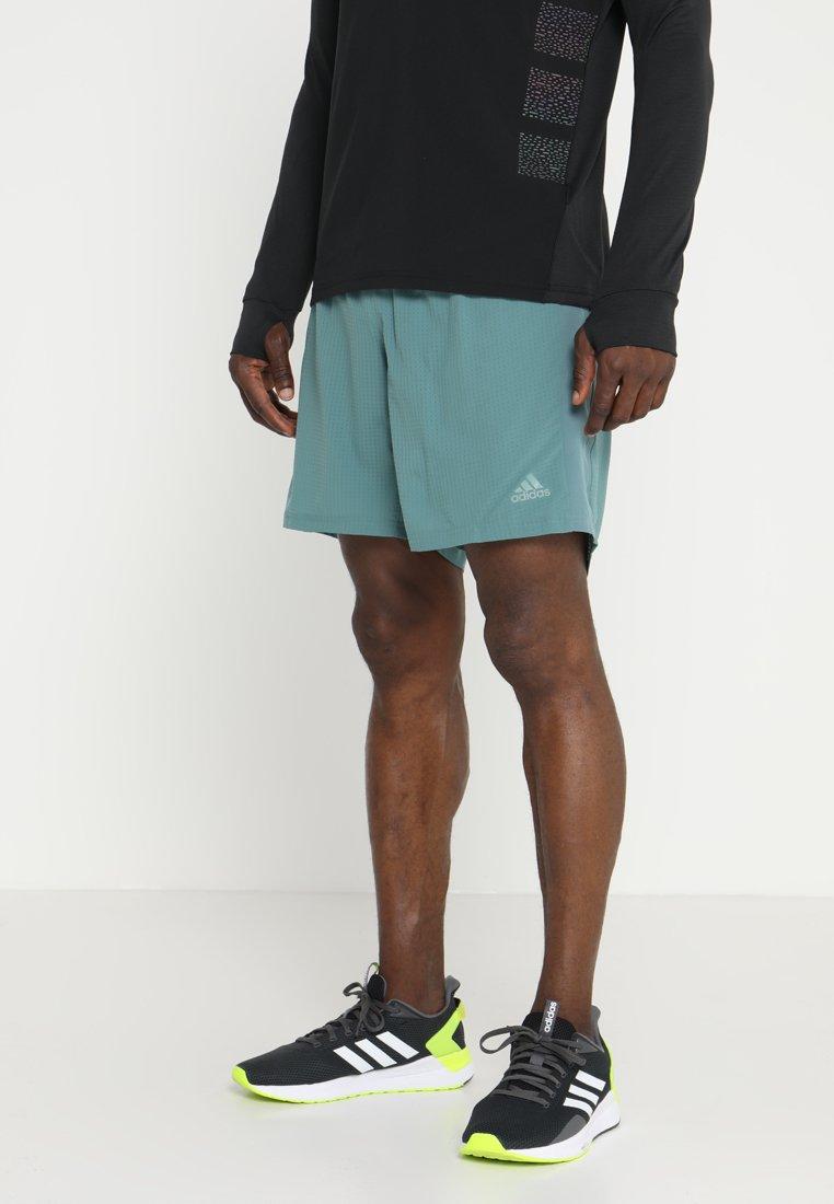 adidas Performance - SUPERNOVA SHORT - Sports shorts - rawgreen