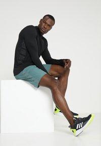 adidas Performance - SUPERNOVA SHORT - Sports shorts - rawgreen - 1