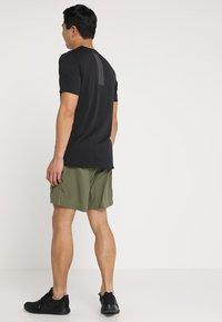 adidas Performance - SUPERNOVA SHORT - Sports shorts - khaki - 2