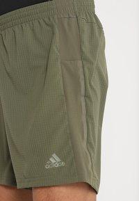 adidas Performance - SUPERNOVA SHORT - Sports shorts - khaki - 4
