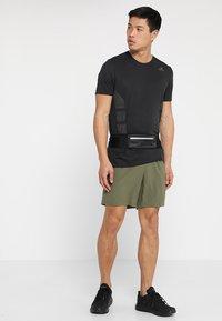 adidas Performance - SUPERNOVA SHORT - Sports shorts - khaki - 1