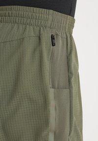 adidas Performance - SUPERNOVA SHORT - Sports shorts - khaki - 3