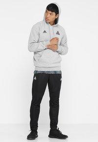 adidas Performance - TANGO AEROREADY CLIMACOOL FOOTBALL PANTS - Teplákové kalhoty - black - 1