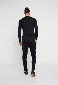 adidas Performance - TAN PANT - Pantalon de survêtement - black/white - 2