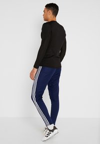 adidas Performance - TIRO AEROREADY CLIMACOOL FOOTBALL PANTS - Tracksuit bottoms - dark blue/white - 2