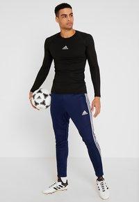 adidas Performance - TIRO AEROREADY CLIMACOOL FOOTBALL PANTS - Tracksuit bottoms - dark blue/white - 1