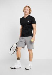 adidas Performance - CLUB SHORT - Sports shorts - grey/glow green - 1