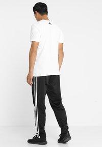 adidas Performance - TIRO - Træningsbukser - black/white - 2