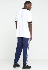 adidas Performance - TIRO 19 - Träningsbyxor - darkblue/white - 2