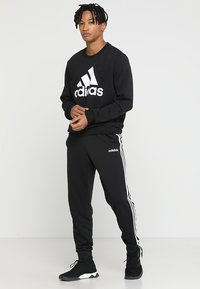 adidas Performance - Pantalon de survêtement - black/white - 1