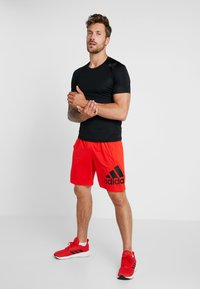 adidas Performance - Sports shorts - active red - 1