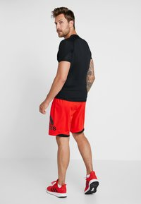 adidas Performance - Sports shorts - active red - 2