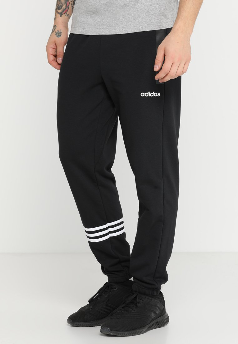 adidas Performance - Essentials Motion Pack Tapered Cuffed Pants - Pantalones deportivos - black
